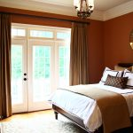 Classic Style Of Bedroom With Brown Painting Pretty Chandelier White Bed And Big Curtains