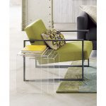 Clear nesting side tables a reading chair with throw pillow a yellow covered book