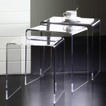 Clear nesting side tables with a cup of coffee