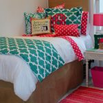 Colorful Bedding Design With Pillows And Red Carpet Near Small Table
