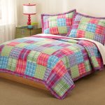 Colorful Pattern Of Bed Sheet With Simple Brown Bed Frame And Carpet Small Lamp