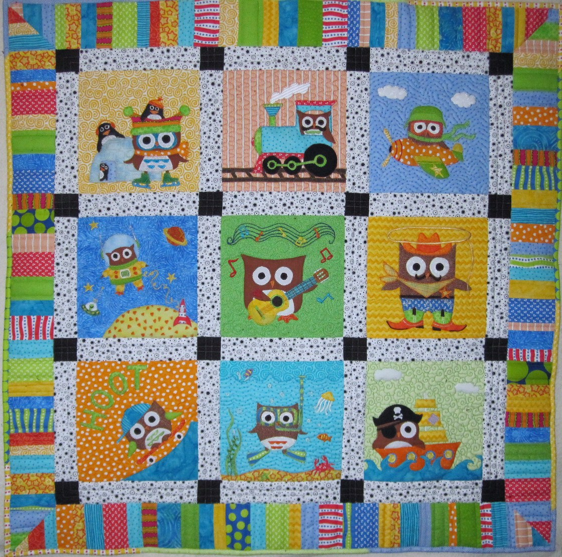 Colorful baby boy quilt with cute pictures