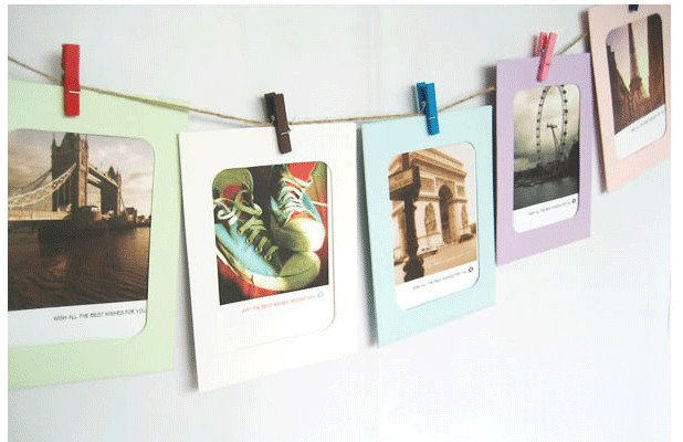 Colorful wood clips as decorative photo hanging tools