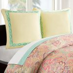 Comfortable bedding by Echo design with cream pillowcases with decorative pattern