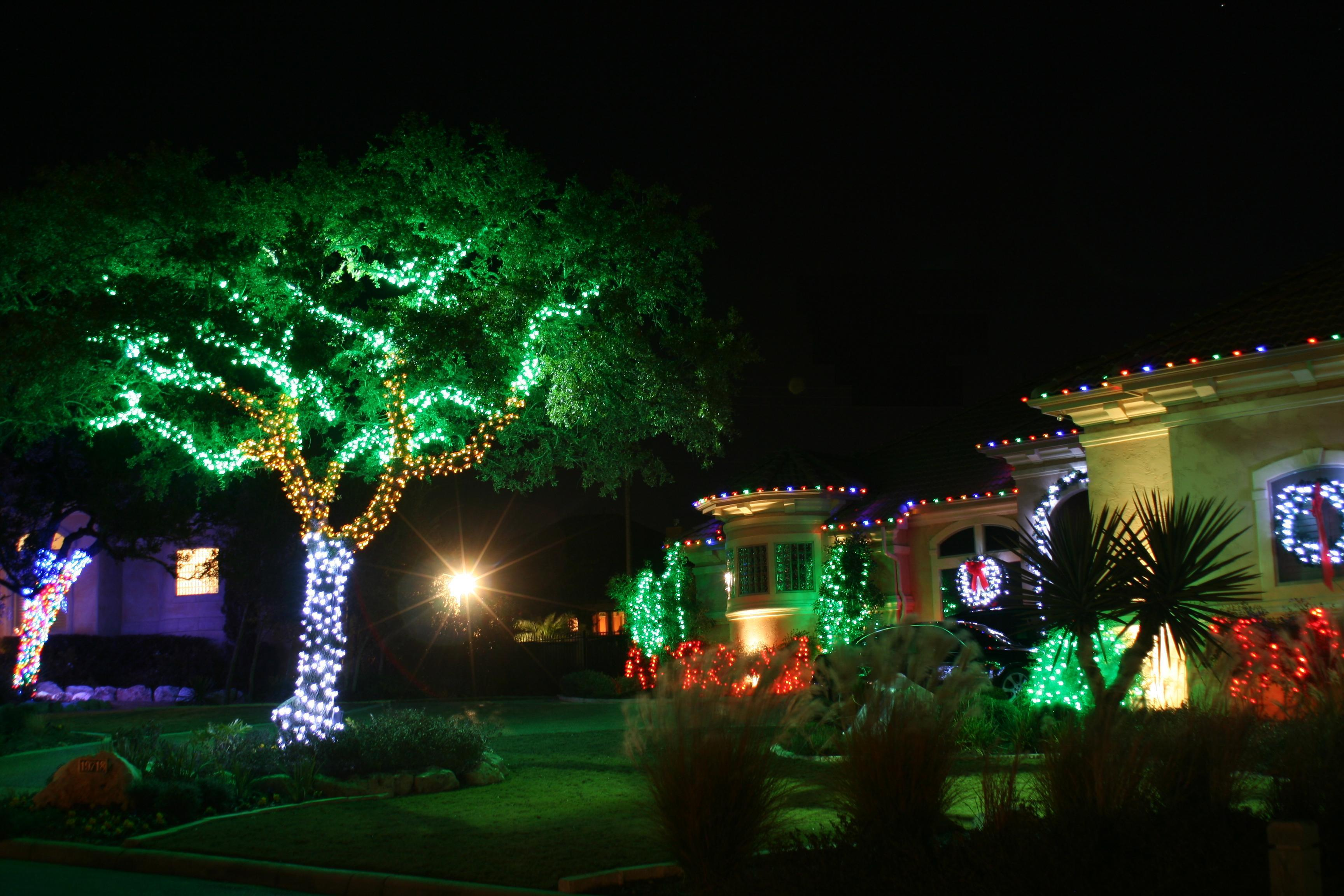 cool outdoor christmas decoration on house and trees electrical lighting