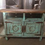 Cool and chic distressed cabinet with shelves and wood top