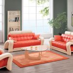 Cool and unique leather couch sets in orange color with orange leather pillows a glass top coffee table an orange rug idea a taller bookcase in white