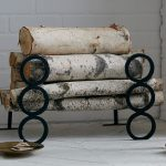 Cool log storage idea with black metal rings decoration
