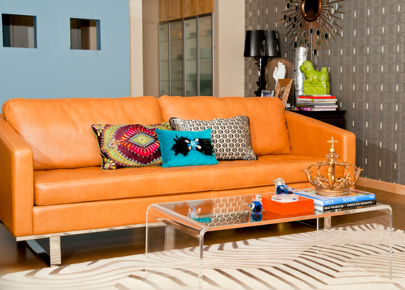 Charmant Cool Orange Leather Sofa With Colorful Pillows A Glass Top Coffee Table  With Metal Frame And
