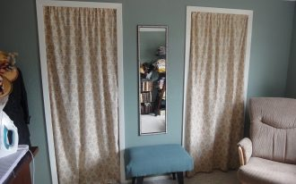 Cream And Stylish Pattern Design Of Curtains Door With Small Table And A Recliner Long Mirror On Wall Decor