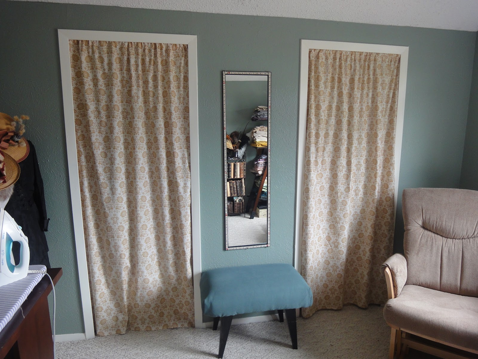 Cream And Stylish Pattern Design Of Curtains Door With Small Table And A  Recliner Long Mirror