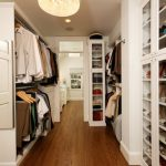 Crystal chandelier light fixture and a recessed lighting fixture in closet room
