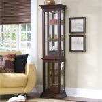 Curio Cabinet Furniture With Long Shape Near Yellow Sofa With Pillows And Brown Shader On Window