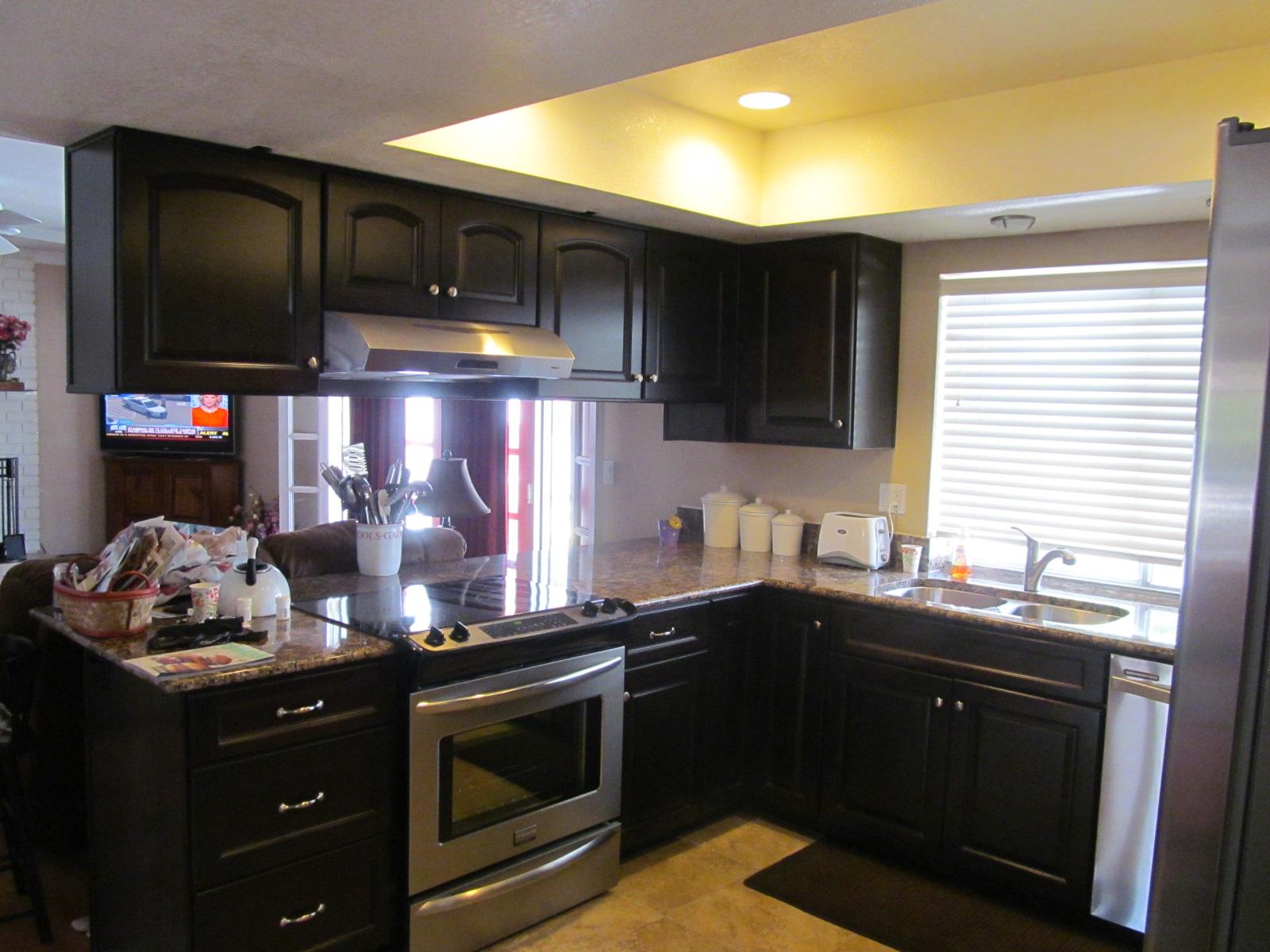 Dark cabinet of kitchen wood set with shader on window