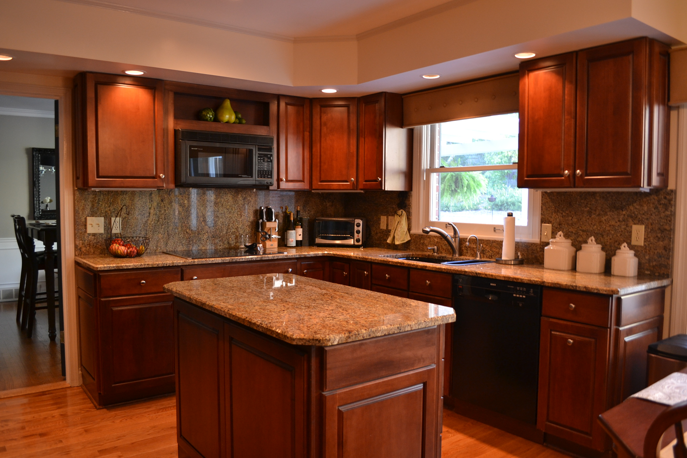 Dark Cabinet With Brown Color On ITs Kitchen Set