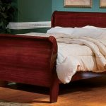 Deep brown stained wood sleigh bed idea with white bed linen and bedcover