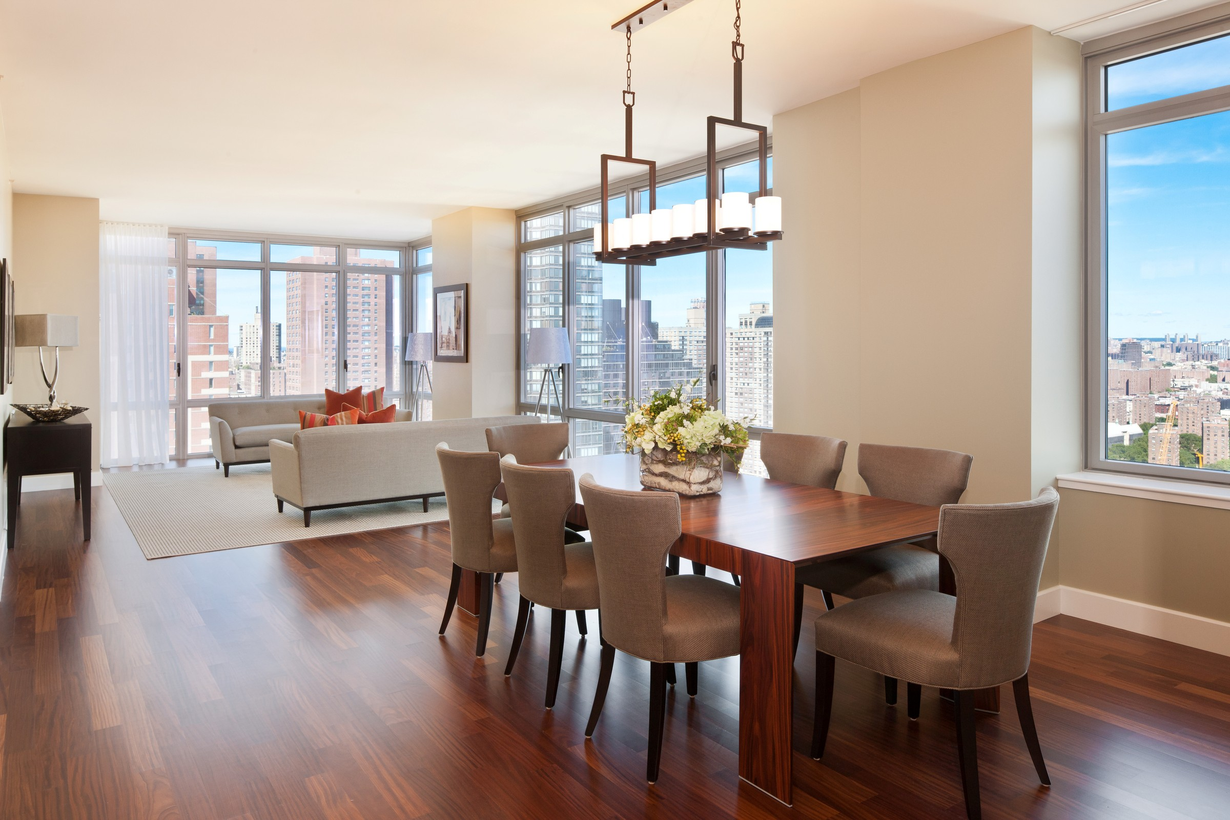 Dining Room With Rectangular Wooden Table Grey Chairs Cool Chandelier Near White Sofas Of Living