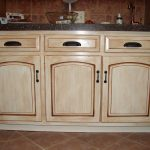 Distressed cabinets in light brown color scheme