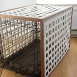 Dog Crate With Square Holes And Brown Mattres