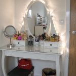Elegant White Polished Wooden Makeup Table With Lights And Oval Mirror