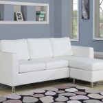 Elegant modern white sectional with chaise unique modern area rug large wall niche for displaying a picture frame books and decorative vase