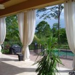 Elegant white exterior draperies for patio a white ceiling fan with lamp