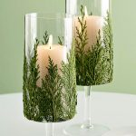 Evergreen candle wrapped in transparent glass candle holders