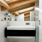 Exposed Beams In Bathroom With Skylight Ceiling White Backsplash Glass Door Shower