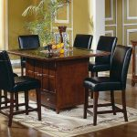 Glass And Wooden Kitchen Table Set And Black Chair On Best Rug