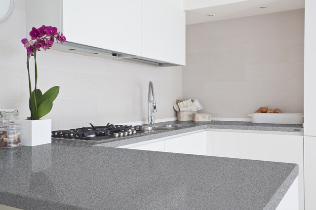 Glossy Grey Quartz Countertop With Gas Stove Sink And Faucet Minimalist  White Cabinet On Top
