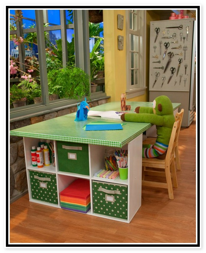 Craft Table for Kids Designs Materials and Complements  : Green top desk for crafting with shelving unit at side of desk a wooden chair for kid from homesfeed.com size 697 x 855 jpeg 146kB