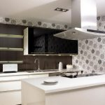 Grey and black flower motif wallpaper for backsplash floating shelves black glass door wall cabinet white base cabinet and  drawer built in sink and faucet white kitchen island with electric stove