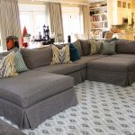 Grey cover for sectional furniture with pillows a modern area rug