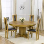 Hardwood round table with four hardwood chairs with higher back and black leather cushion