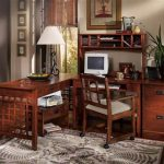Home office desk in mission style with mission wodden chair a floral area rug