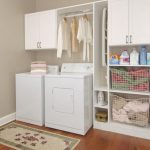 IKEA wall cabinet systemidea with metal rod and shelves for laundry room a washer machine and a dryer machine  a mat for laundry room
