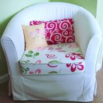 Ikea Chair Covered White And Red With Pillows