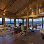 Interior Mountain Home With Showing Beams And Hardwood Floor Large Sectional Sofa And Warm Carpet