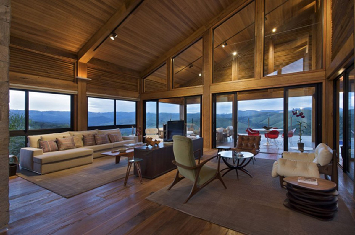Interior Mountain Home With Showing Beams And Hardwood Floor Large Sectional Sofa Warm Carpet
