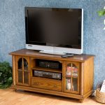 Kmart Wooden TV Stands With Storage Place Hardwood Floor And Blue Wall