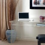 Large clear nesting table as computer desk a backless black chair