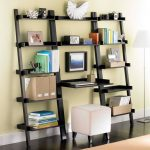 Larger leaning ladder bookshelf with desk and a white ottoman
