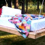 Larger white mattress in hanging outdoor daybed unit