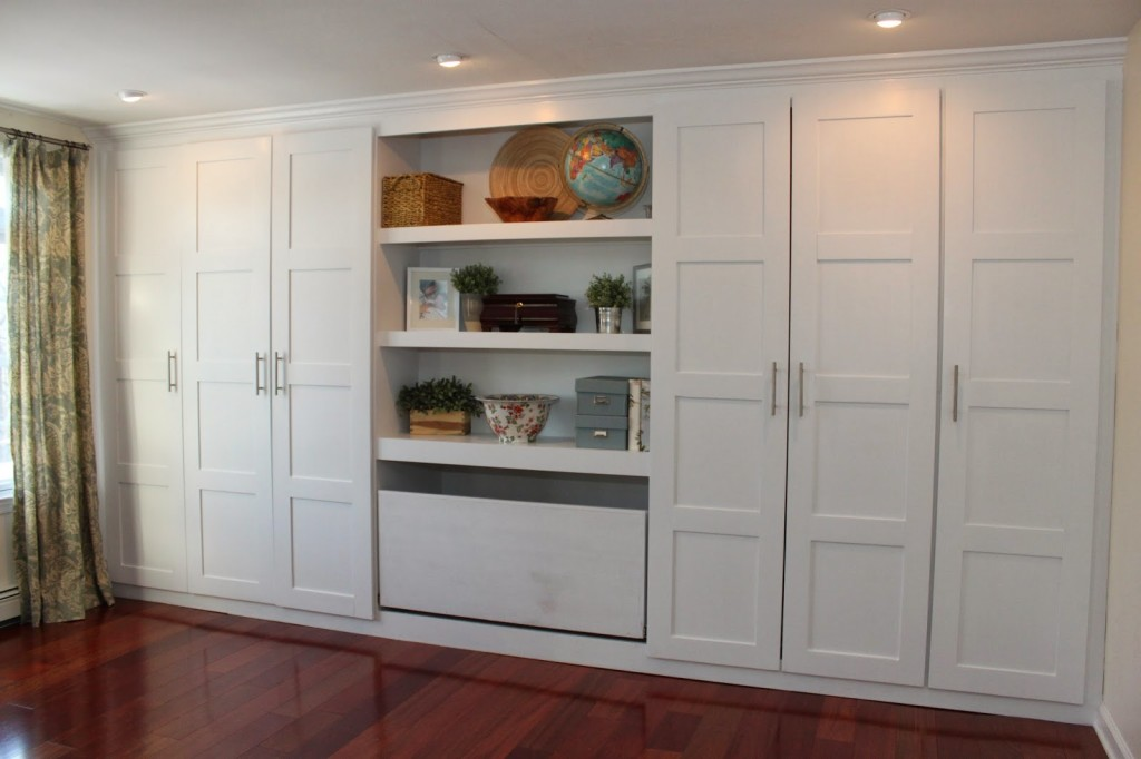 larger white wood dresser for closet design with shelving unit in the middle living room