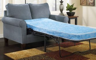 Light blue loveseat with additional customized sleeper