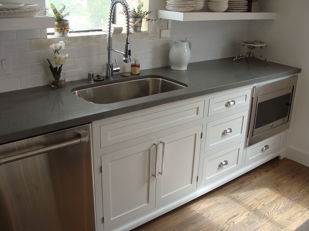 Light Grey Quartz Kitchen Counter With Wide And Deep Sink And Faucet