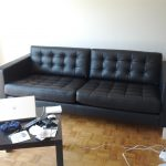 Long And Black Sofa With Wood Table