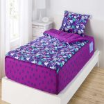 Love Shaped And Purple Color Blanket Pillow of Bed Sheet On White Bed Frame And White Room