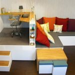 Matroshka-collection-multipurposed-furniture-by-Russion-dolls-using-versatile-pieces-for-desk-and-sofa-with-red-orangeand-white-cushions-also-stairs-and-brown-floor-also-grey-chair