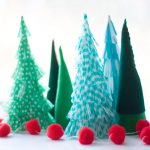 Mini Christmas trees made from unused materials that are shaped into beautiful cones